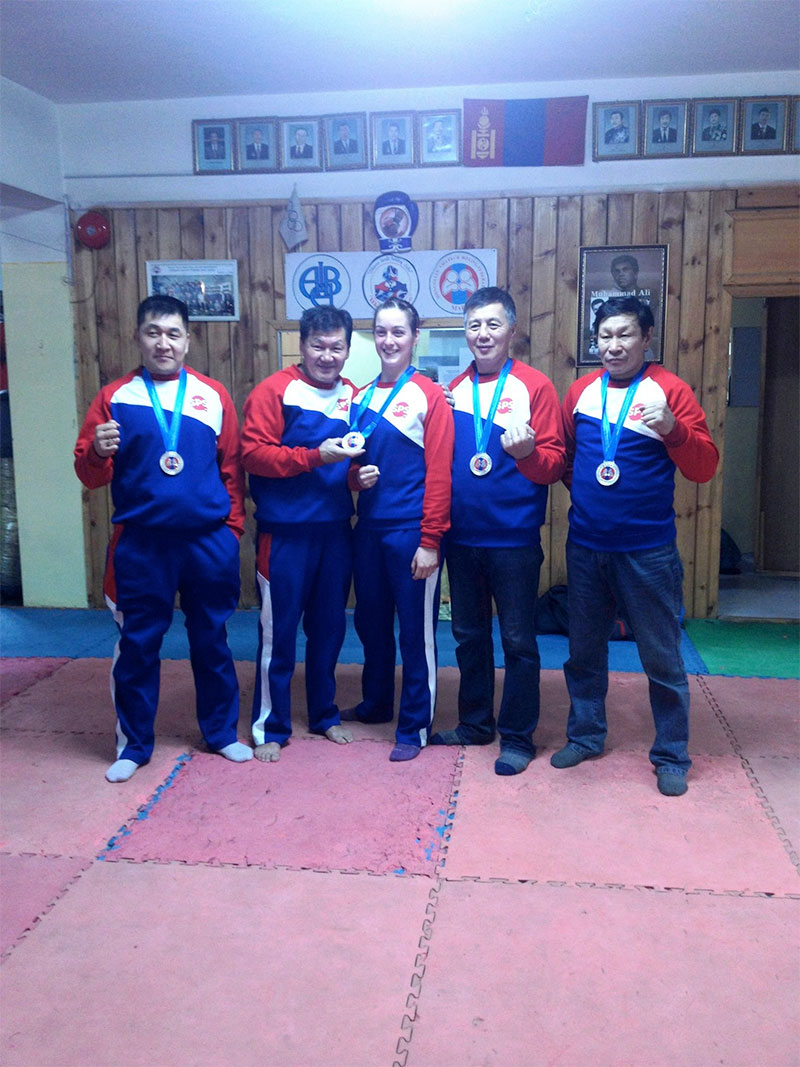 "Isabelle Maffat with four coaches of ""Shiren Beelii"" boxing club"