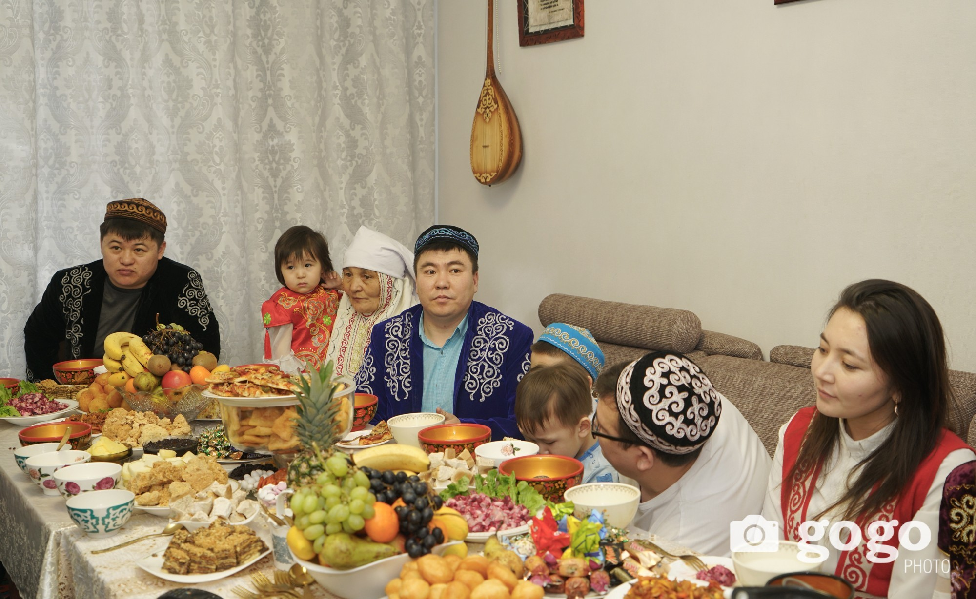 Kazakh people put on traditional clothes decorated with hand embroidery on Nawryz holiday.