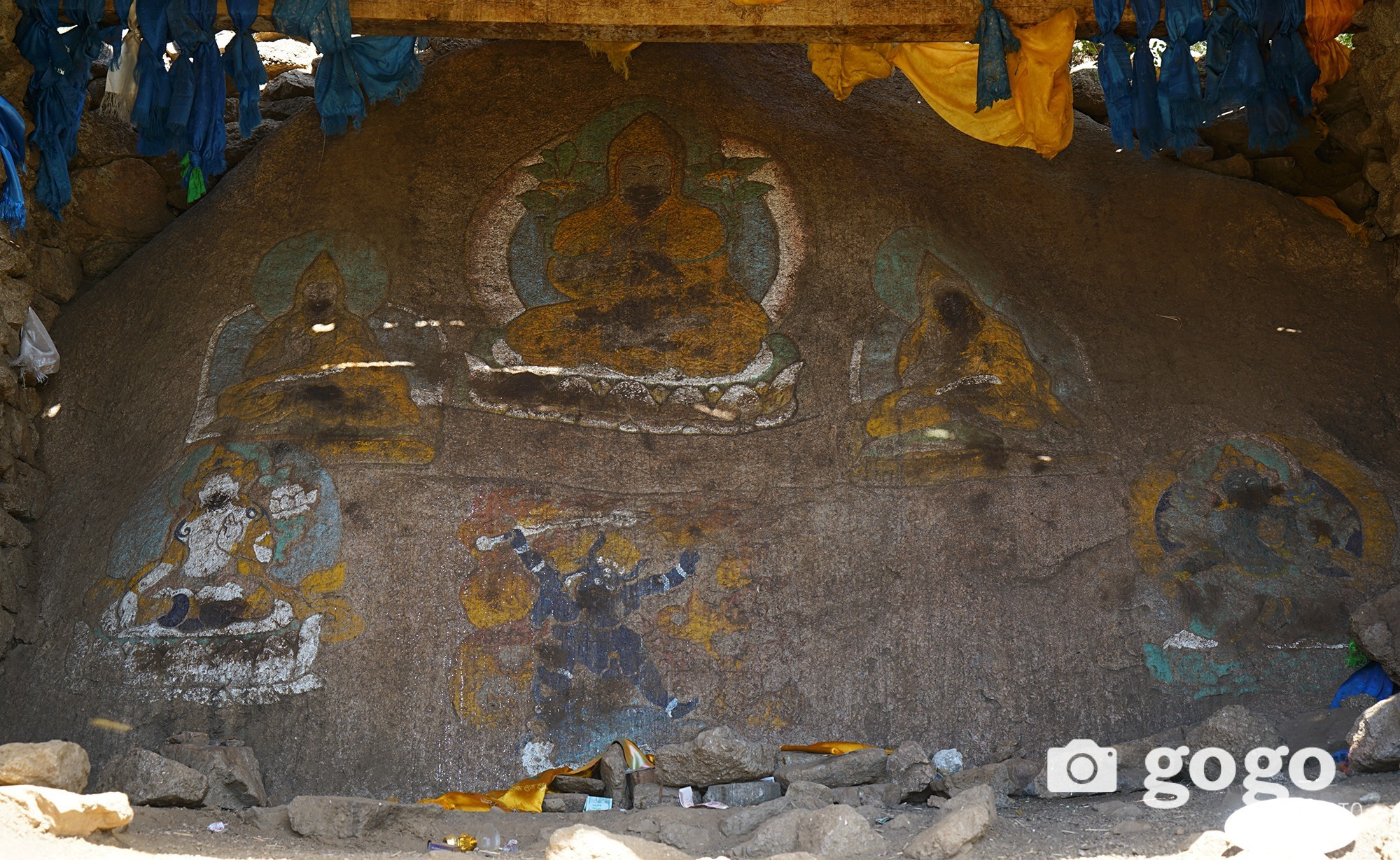 Buddhist deities painted on the rocks
